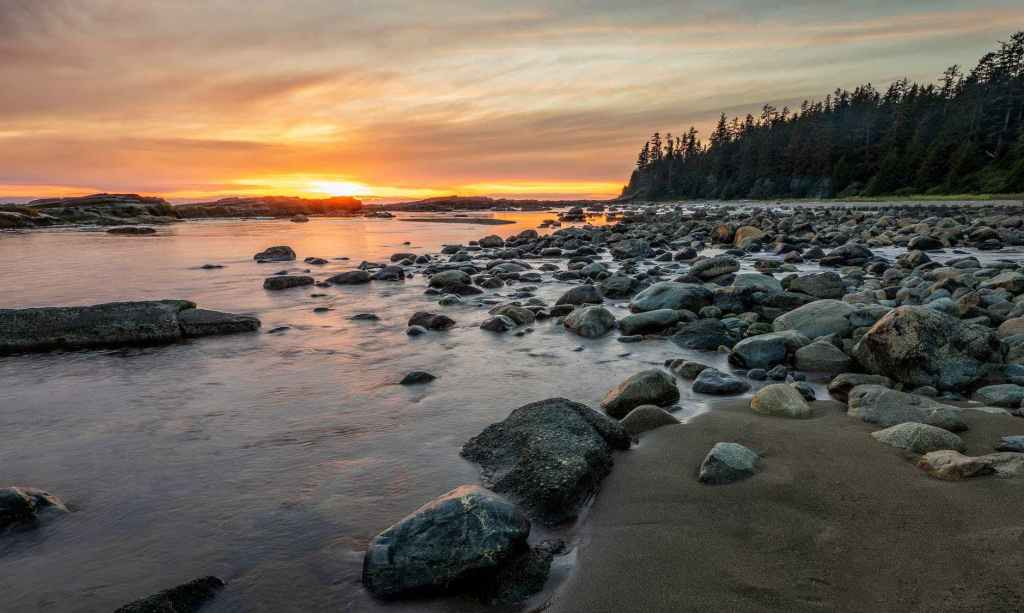 rocky shore with rocks on the shore during sunset